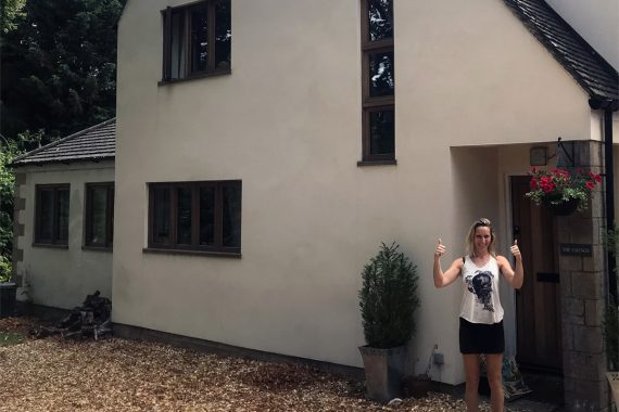 modern-machine-rendered-house-in-cirencester-with-happy-homeowner