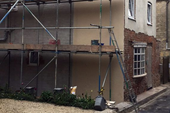 red brick house preparation-with-scratch-coat-render-before colour rendering applied