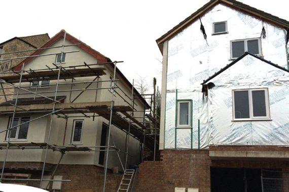 timber frame house with external wall insulation installed before colour render applied